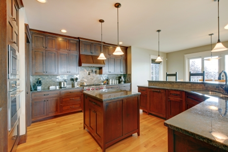 14874104 - luxury pine wood beautiful custom kitchen interior design with island and granite.